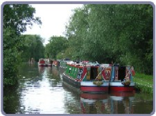 Allen boats moored along canal nr Marina
